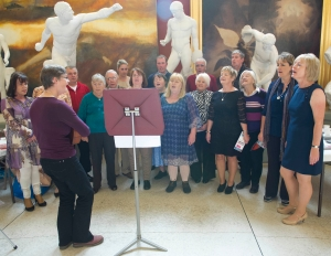 Members of The Leeside Serotones performing with Choral Leader Liz Powell at Crawford Art Gallery, October 2013 (pic. Ger McCarthy)